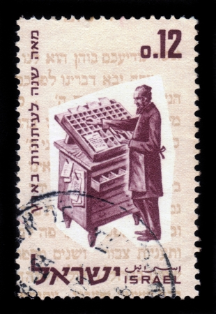 Israel - CIRCA 1963: a stamp printed by Israel shows a jewish type-setter of a century ago, is gaining page newspaper ' Halbanon ' in 1863, circa, 1963 Stock Photo - 17377847