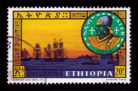 amharic: ETHIOPIA - CIRCA 1962   A stamp printed in Ethiopia shows portrait of ethiopian rulers, king Kaleb and fleet in Adulis port  , with the inscription in Amharic , series, circa 1962
