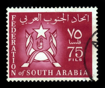 aden: South Arabia - CIRCA 1966: A stamp printed in Federation of South Arabia shows the image of the coat of arms of Federation of South Arabia, circa 1966