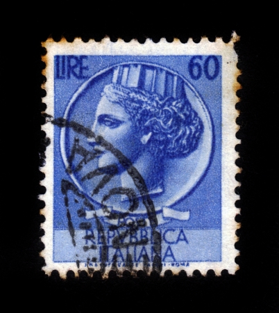 turreted: ITALY - CIRCA 1953  A stamp printed in Italy from the  Italy turreted  Syracuse   issue shows an Ancient coin of Syracuse, circa 1953