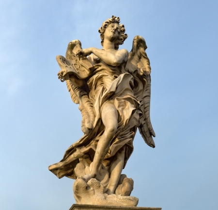 statue of an angel standing on the bridge leading to the Castle Sant Angelo, Rome Stock Photo - 17491256