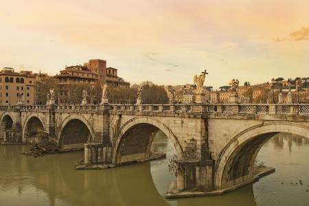 Sant Angelo Bridge at sunset, Rome, Italy Stock Photo - 17499301