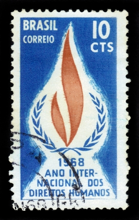 Brazil - CIRCA 1968  stamp printed in  Brazil, shows Human Rights Flame - symbol of International Year of Human Rights, circa 1968 Stock Photo - 17491261