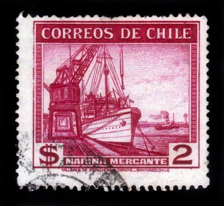 CHILE - CIRCA 1936  A stamp printed in Chile shows port crane and merchant ship, circa 1936 Stock Photo - 17499289