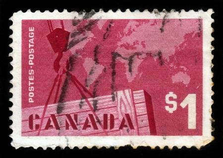importer: CANADA - CIRCA 1963: a stamp printed in the Canada shows Export Crate and Mercator Map, circa 1963 Stock Photo