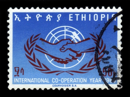 Ethiopia - CIRCA 1965: A Stamp printed in Ethiopia shows handshake, symbol of the International Cooperation Year of the UN, circa 1965 photo