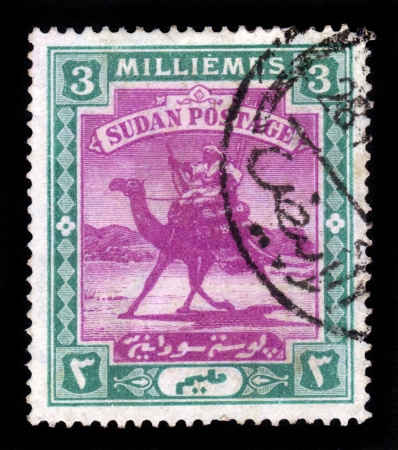 SUDAN - CIRCA 1898: A stamp printed in Sudan shows Arab postman, 5 millieme ,seria The Camel Post , circa 1898 Stock Photo - 17499336