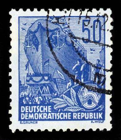 GDR - CIRCA 1953: A stamp printed in GDR (German Democratic Republic - East Germany) shows descent to water of the new ocean-going ship, from the series Workers For The Five-year Plan, circa 1953 Stock Photo - 17491268