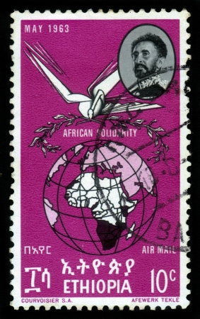 ETHIOPIA - CIRCA 1963 : A stamp printed in Ethiopia shows image of  emperor Haile Selassie and globe with map of a African continent, with the inscription in Amharic , circa 1963