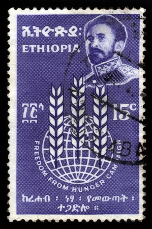 haile: ETHIOPIA - CIRCA 1963 : A stamp printed in Ethiopia shows image of  emperor Haile Selassie on a blue background , with the inscription : freedom from hunger campaign, circa 1963