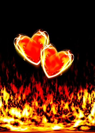 two loving hearts, burning in the flames of love on a black background photo