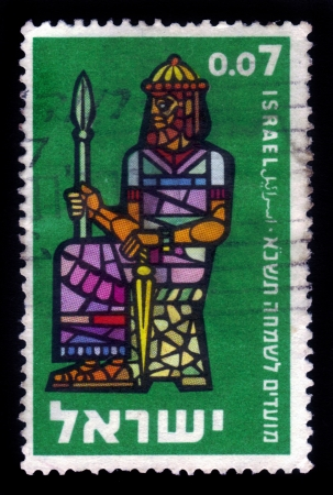 ISRAEL - CIRCA 1960  A stamp printed in Israel, shows symbolic drawing of the first Kings of Israel  Saul ,circa 1960 版權商用圖片