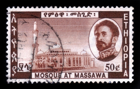 amharic: ETHIOPIA - CIRCA 1968   A stamp printed in Ethiopia shows image of  emperor Haile Selassie and mosque at massawa , Ethiopia , with the inscription in amharic , circa 1968