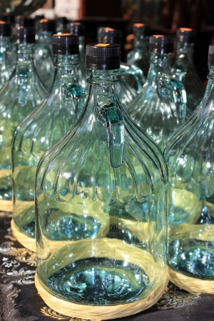 large glass bottles prepared for bottling olive oil Stock Photo - 17757978