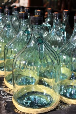 large glass bottles prepared for bottling olive oil Stock Photo - 17757978