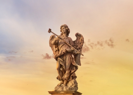 statue of an angel standing on the bridge leading to the Castle Sant Angelo, Rome Stock Photo - 17757966