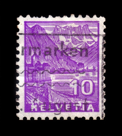 SWITZERLAND - CIRCA 1942  A stamp printed in Switzerland, shows the Chillon Castle, purple background, series, circa 1942 Stock Photo - 17757964