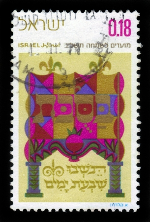 ISRAEL - CIRCA 1971  A stamp printed in Israel, shows Decorated writing Bible verses , is dedicated to the holiday of Sukkot 5732-1971 , circa 1971 Stock Photo - 17757972