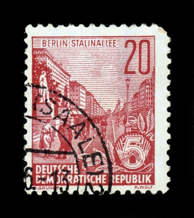 GERMANY - CIRCA 1955: A stamp printed in Germany, shows Stalin avenue in Berlin, series Five year plan, circa 1955 photo