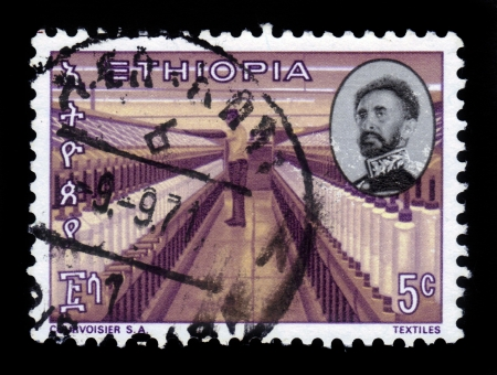 haile: ETHIOPIA - CIRCA 1971   A stamp printed in Ethiopia shows portrait of emperor Haile Selassie and textile factory , with the inscription in amharic , series, circa 1971