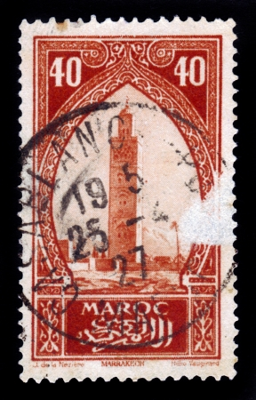 MOROCCO - CIRCA 1934  A stamp printed in Morocco shows Koutoubia, the biggest mosque of the Moroccan city of Marrakesh, red, circa 1934 Stock Photo - 17881684