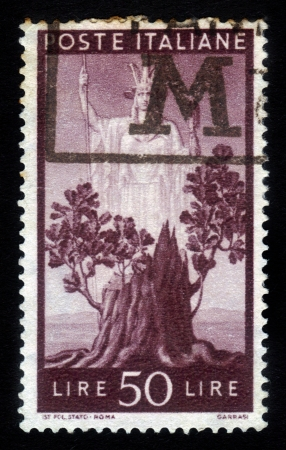 ITALY - CIRCA 1945  A stamp printed in Italy, shows the  Italia  and Sprouting Oak Stump, from the series  Italia  , circa 1945 Stock Photo