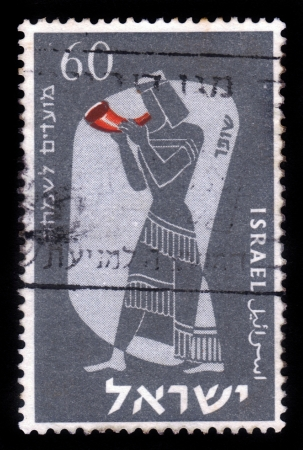 ISRAEL - CIRCA 1955  A stamp printed in Israel, shows symbolic drawing of musician and musical instruments of biblical times - shofar, horn ,circa 1955 photo
