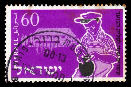 ISRAEL - CIRCA 1955  A stamp printed in Israel, shows young boy being trained, to potter s craft ,  issued in honor of 20th anniversary of Youth Aliyah , training of the crafts, series, circa 1955 Stock Photo - 17881746