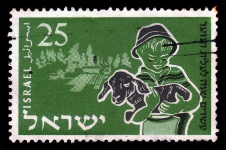 ISRAEL - CIRCA 1955  A stamp printed in Israel, shows boy holding in his arms lamb ,  issued in honor of 20th anniversary of Youth Aliyah with inscription  Agricultural education , series, circa 1955 Stock Photo - 17881742