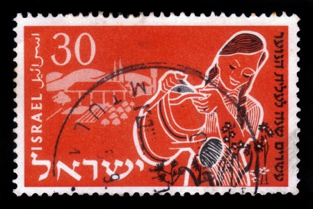 ISRAEL - CIRCA 1955  A stamp printed in Israel, shows young woman watering flowers ,  issued in honor of 20th anniversary of Youth Aliyah ,agricultural education women, series, circa 1955 Stock Photo - 17881776