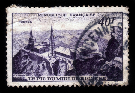 FRANCE - CIRCA 1951  A stamp printed in France shows weather station PIc du midi de Bigorre , observatory in the French Pyrenees  , circa 1951 Stock Photo - 17990245