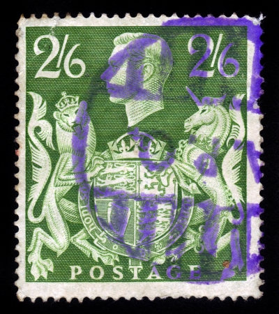 UNITED KINGDOM - CIRCA 1939   a stamp printed in England, shows an  portrait of king George VI , lion and unicorn holding a royal coat of arms, circa 1939 Stock Photo - 17990249