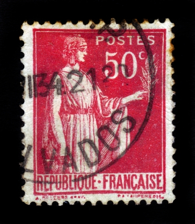 signifier: FRANCE - CIRCA 1933  A stamp printed in France shows a woman with an Olive Branch in hand - allegory of Peace , red, from the series  Peace , circa 1933
