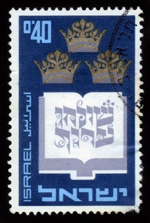 mishnah: ISRAEL - CIRCA 1967  A stamp printed in ISRAEL shows an open book with inscription  Shulhan Aruch  with three crowns above, circa 1967