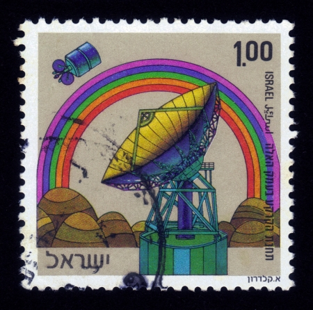 ISRAEL - CIRCA 1972  A stamp printed in ISRAEL shows antenna, satellite, rainbow, satellite ground communication station in the Ha ela valley, circa 1972 Stock Photo