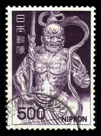 wooden post: JAPAN - CIRCA 1969  A post stamp printed in Japan shows Deva King statue, Kongo Rikishi, manifestation of the hindu god Vishnu, wooden figure, circa 1969 Stock Photo