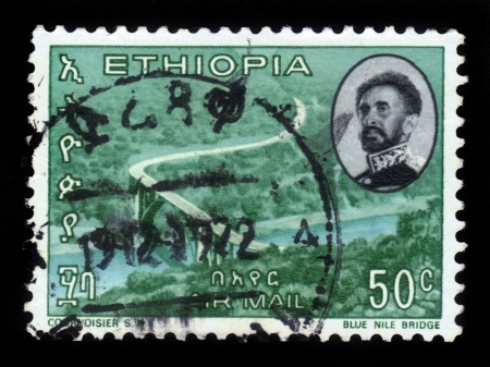 haile: ETHIOPIA - CIRCA 1965  A stamp printed in Ethiopia shows  portrait of emperor Haile Selassie and  bridge over blue nile river , circa 1965 Stock Photo