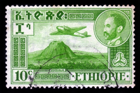 haile: ETHIOPIA - CIRCA 1950  A stamp printed in Ethiopia shows  portrait of emperor Haile Selassie and plane Douglas DC-3 over Zoquala Volcano, circa 1950 Editorial