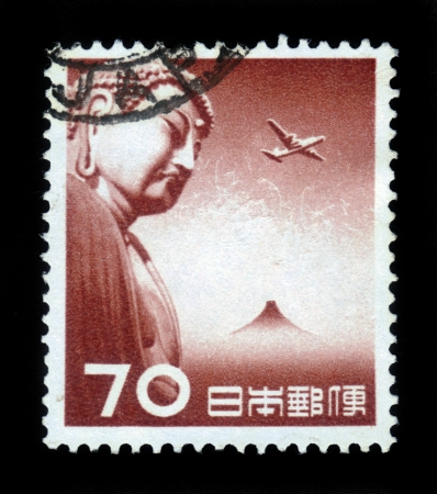 JAPAN - CIRCA 1953  A stamp printed in Japan shows Great Buddha of Kamakura and airplane flying over Fuji, circa 1953 Stock Photo - 18149204