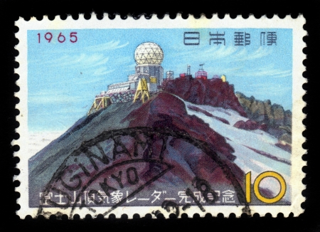 JAPAN - CIRCA 1965  A stamp printed in Japan shows Mount Fuji weather station, circa 1965 Stock Photo - 18149761