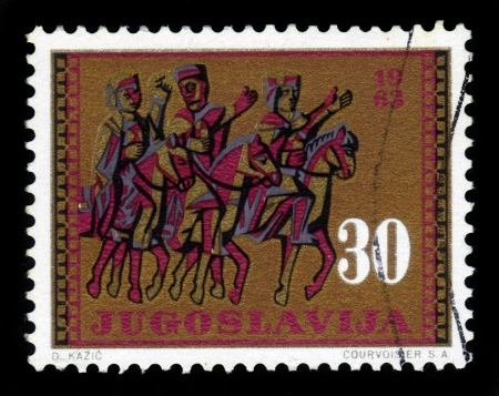 Yugoslavia - CIRCA 1963  a stamp printed in the Yugoslavia shows three horsemen, fragment of the door of the cathedral of the XIII century in Split, Croatia, circa 1963 Stock Photo - 18149208
