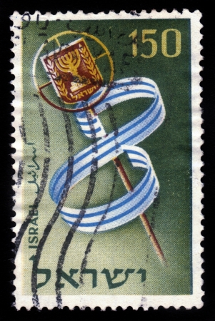 Israel - circa 1956: A stamp printed in Israel, shows the emblem of the State and a blue/white pennant forming the figure 8 , devoted to Independence Day and Memorial Day for the Fighters for independence, circa 1956 Stock Photo - 18171449