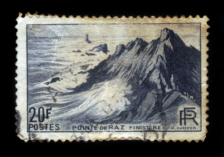 FRANCE - CIRCA 1946  stamp printed by France, shows lighthouse on Cape Sizun, Pointe du Raz  Brittany, France, circa 1946