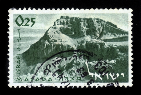 ISRAEL - CIRCA 1965  A stamp printed in Israel, shows mountain Masada and ruins of ancient fortress of King Herod s , near Dead Sea ,circa 1965 Stock Photo - 18222663