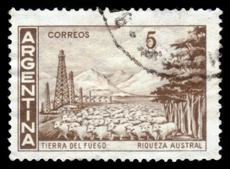 ARGENTINA - CIRCA 1959: A stamp printed in the Argentina, shows landscape of the Tierra del Fuego and flock of sheep, circa 1959 Stock Photo - 18222651
