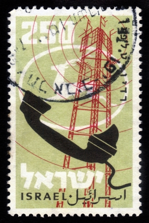 ISRAEL - CIRCA 1959: A stamp printed in Israel, shows retro telephone and logo  of mail of Israel  ,circa 1959 Stock Photo - 18222654