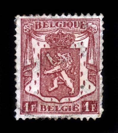 BELGIUM - CIRCA 1912  A stamp printed in Belgium shows Belgian coat of arms, heraldic lion, circa 1912 Stock Photo - 18302899
