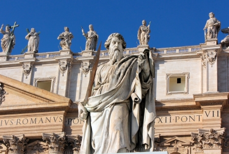 catholical: statue of Apostle Paul with a sword in St. Peters Square, Rome