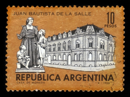 john the baptist: ARGENTINA - CIRCA 1966  A stamp printed in Argentina showing La Salle College and Monument of John Baptist de La Salle, circa 1966 Editorial