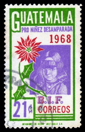 homeless children: GUATEMALA - CIRCA 1968: A stamp printed in Guatemala shows portrait of a little girl , child, dedicated to abandoned and homeless children, circa 1968
